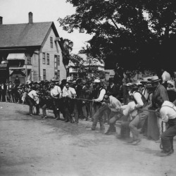 Tug-of-war in front of the store circa 1900